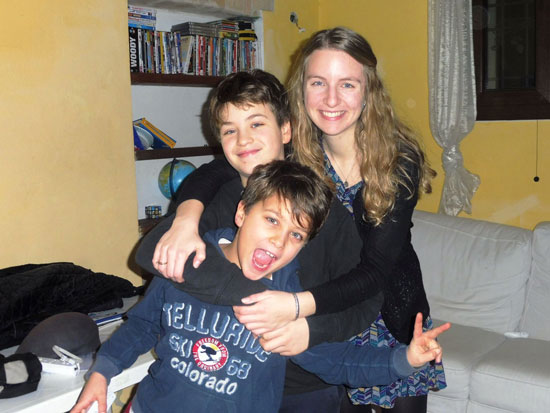A TEFL teacher in South America posing with her students.
