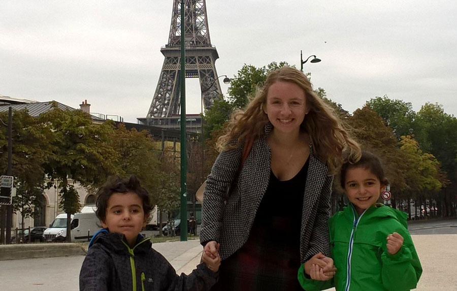 Camille, a South American TEFL teacher, with her students in front of the Eiffel Tower.