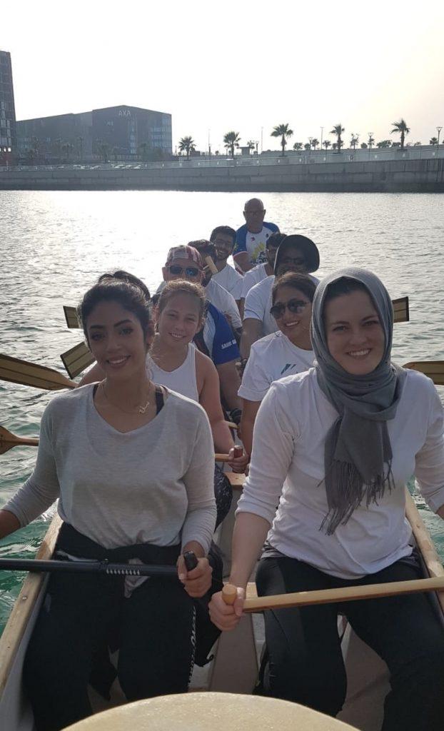 Jasmine, teacher in Bahrain, on a traditional dragon boat