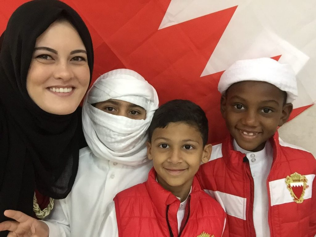 Jasmine, Teacher in Bahrain, with her students