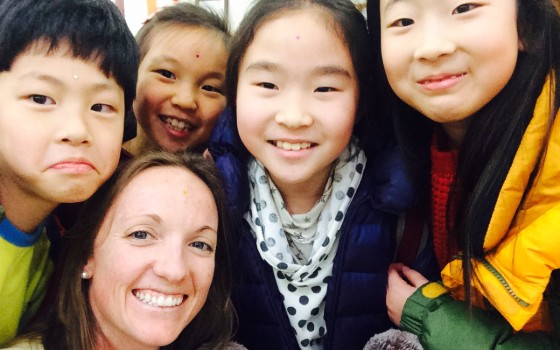 Katie, teacher in South Korea, with her students