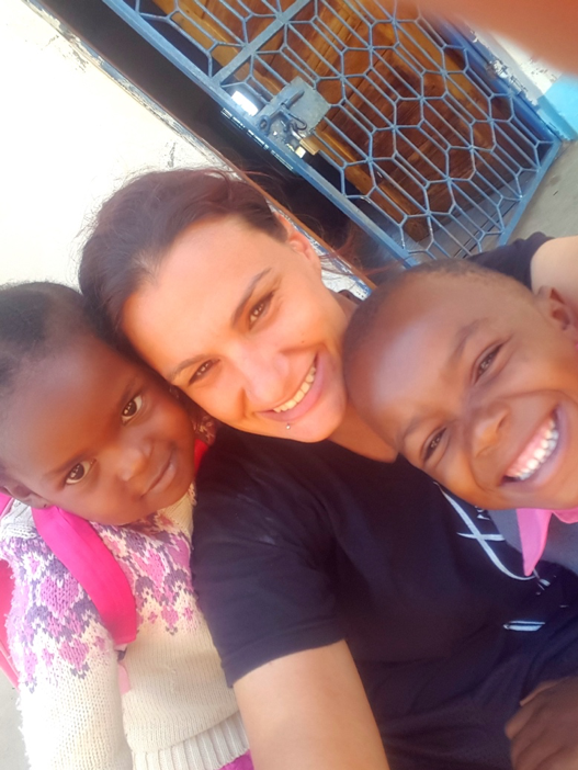 Lindsay with 2 of her ESL students in Tanzania