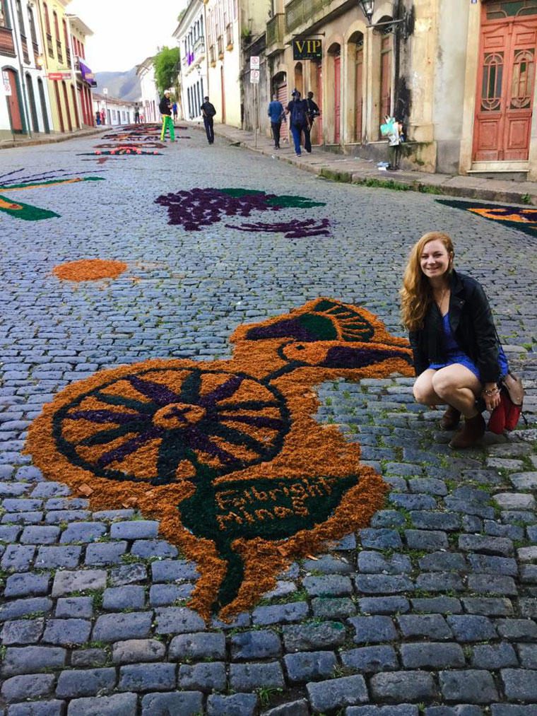 Maggie, an English teacher in Brazil posing with some street art.