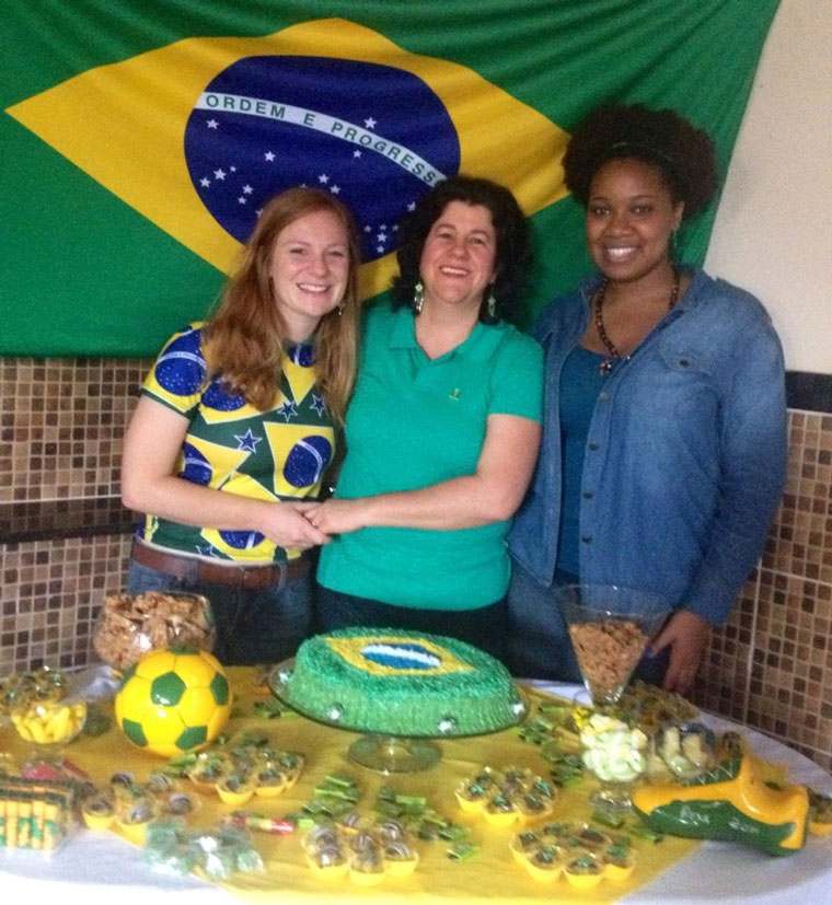 Maggie celebrating a Brazil-themed birthday with a Brazil flag in the background.
