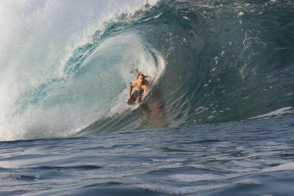 Jay surfing in Indonesia.