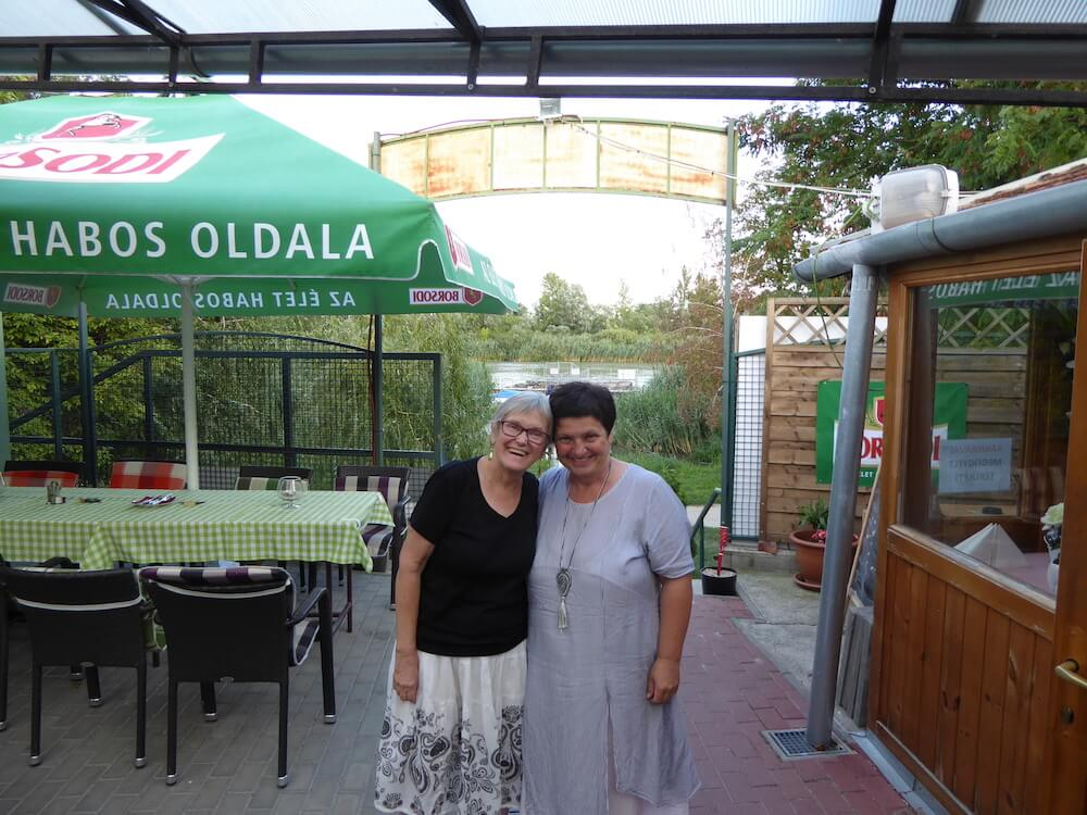 CETP American director Mary Rose and Hungarian director Hajni Vancsik at restaurant on the little Danube in small city of Szigetszentmiklos