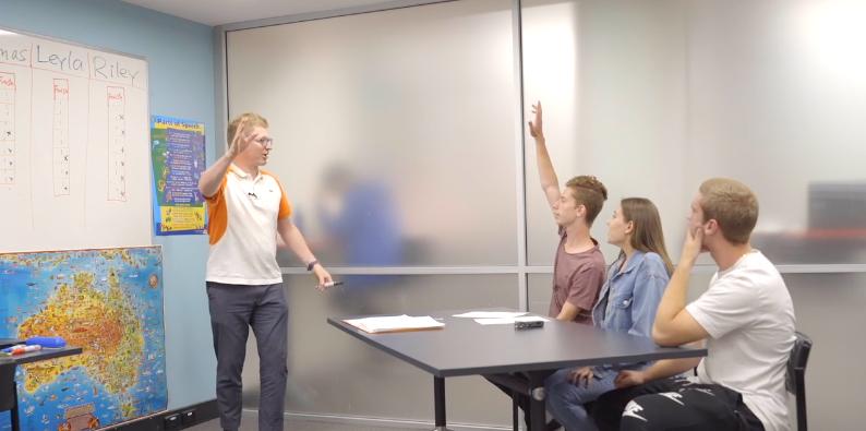 Teacher letting learners speak more in class