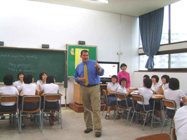 TEFL Teacher with class in Asia