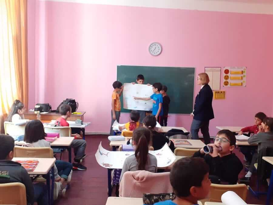 A teacher in Georgia with students