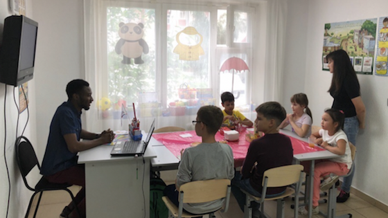 Tariq Adams, a BridgeTEFL graduate from Ghana, teaching a class of English students in Russia