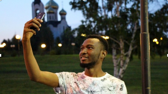 Tariq Adams, teacher in Russia, taking a selfie in his favorite park