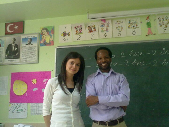 two teachers in front of a chalkboard
