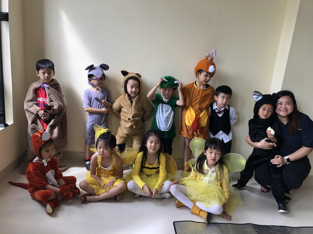 Shella Chua, Filipino Teacher in China with students in costumes