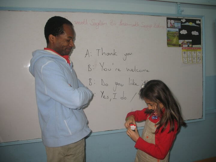 teacher and student at the whiteboard