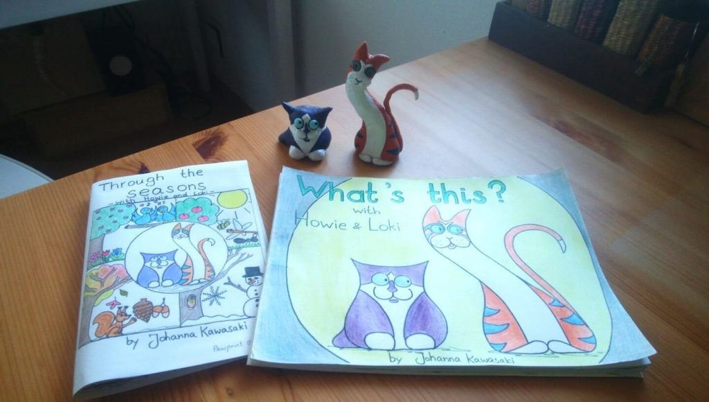 prototypes of Johanna's two EFL learning books and the two characters made out of clay