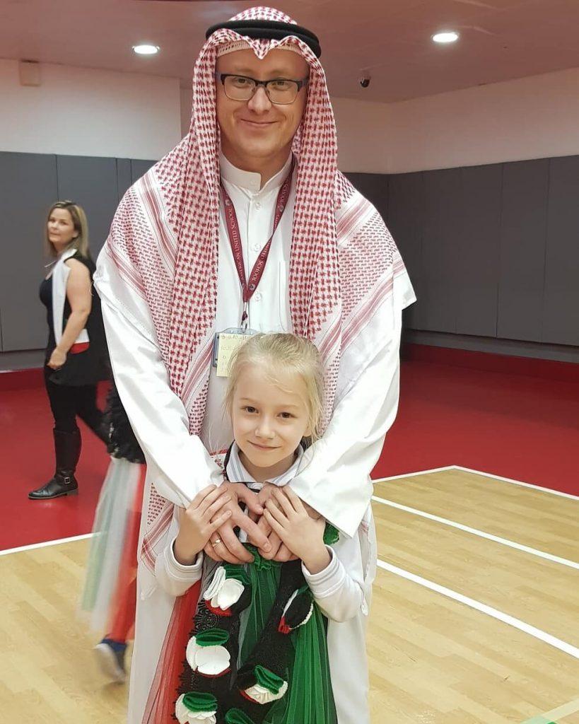 teacher Evgenii with his daughter