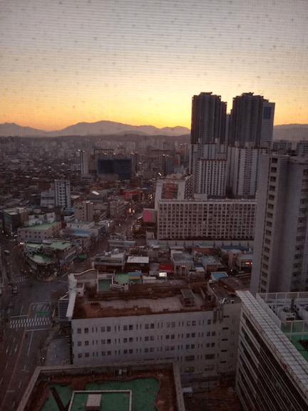 a view of buildings in Seoul from apartment window