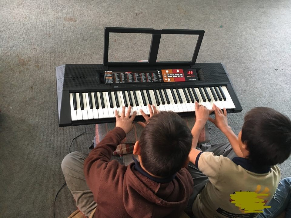Olivia's music students in her previous job