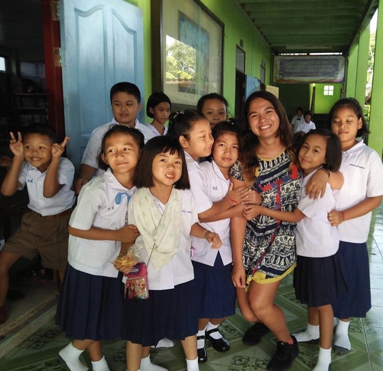 Brenda, an ESL teacher from the U.S., with her students in Thailand