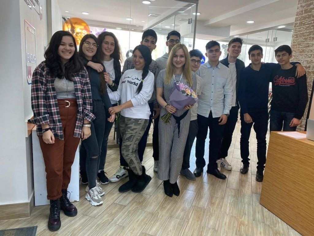 IELTS teacher Nasim, from Iran, with her students