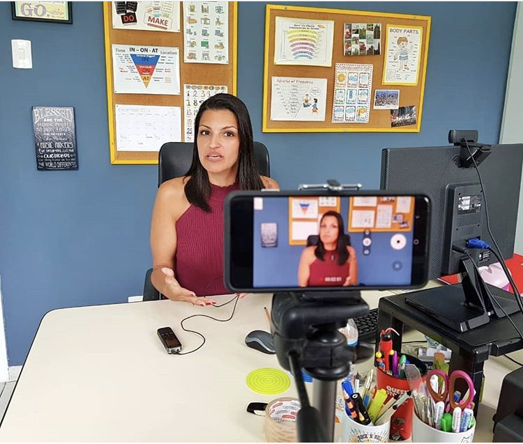 Carla filming her ESL videos for social media