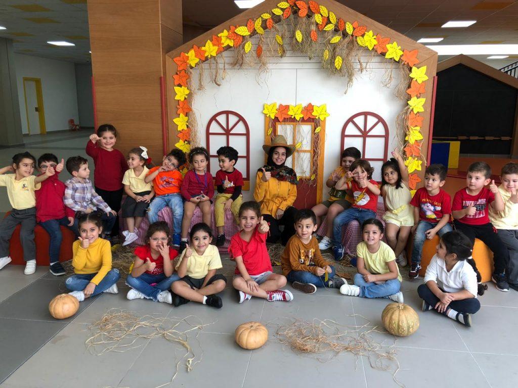 Hawra with her kindergarten students