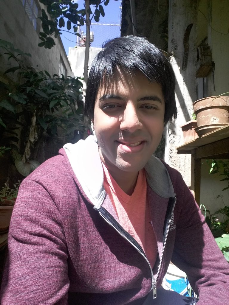 Shakti outside his house in Mauritius