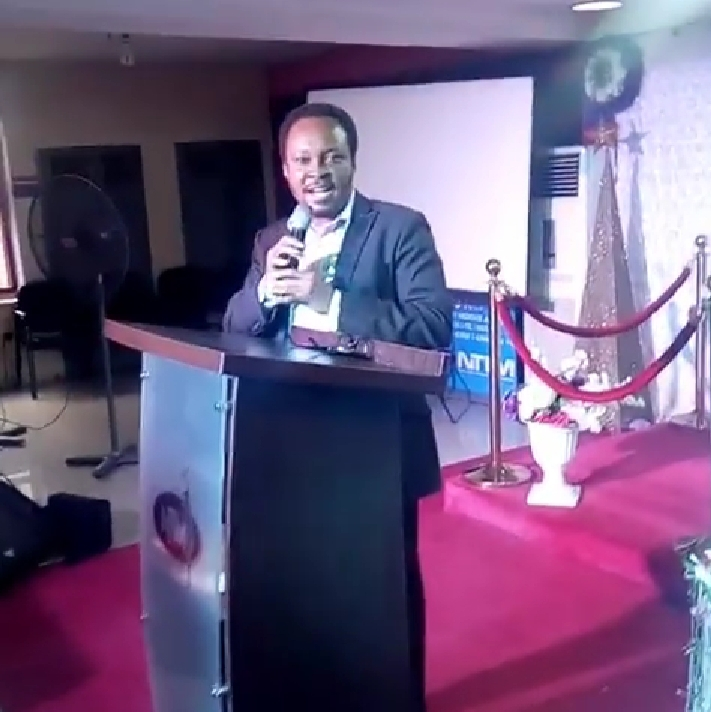 Uchechukwu during a speaking engagement on a book he co-edited