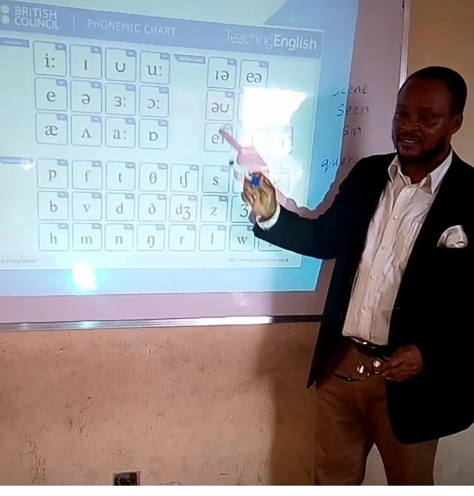 Phonics teacher Uchechukwu, from Nigeria, teaching the phonemic chart