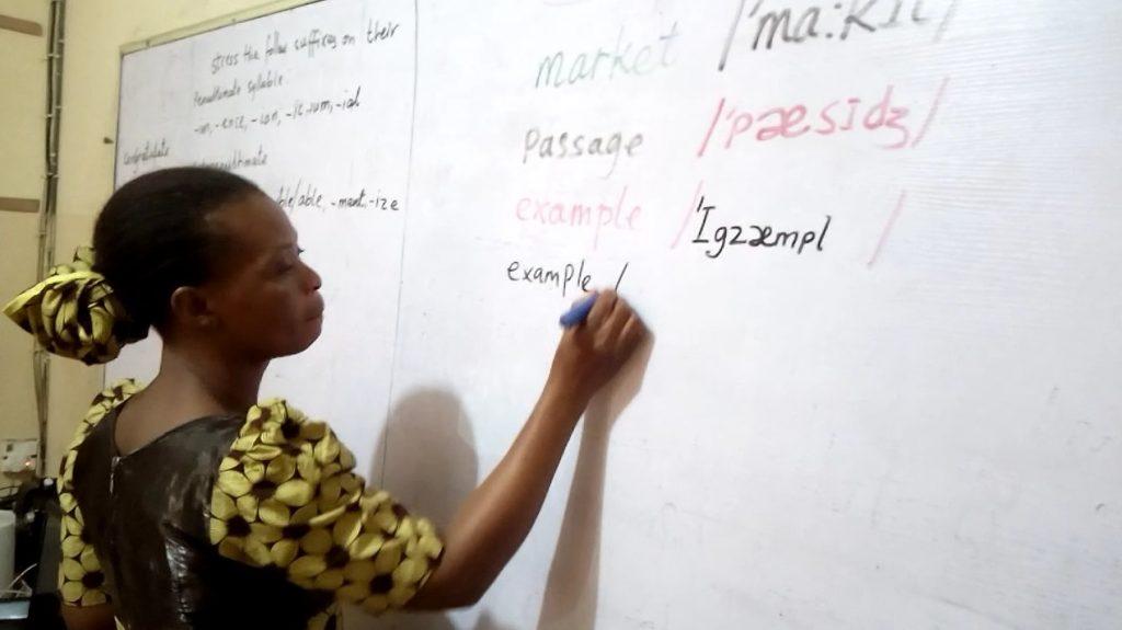 An ESL teacher during a phonics training activity