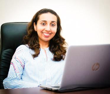 Piya in her office