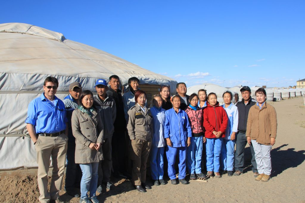 Mark (first on the left) with his Mongolian team at a camp in the Gobi Desert