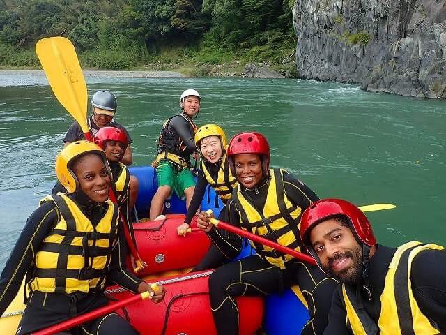 Colette (second row, right) on a rafting adventure with her colleagues