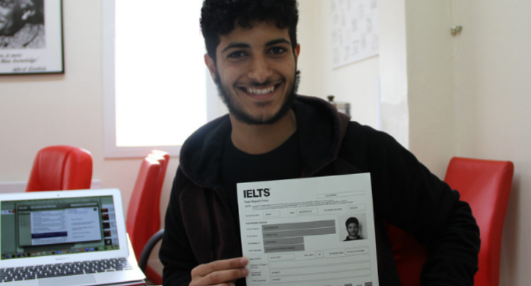 A student poses with the results of his IELTS English language test.