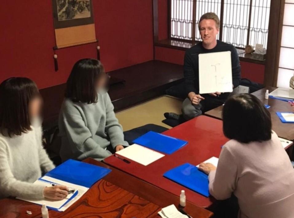 Chris giving an ESL conversation class