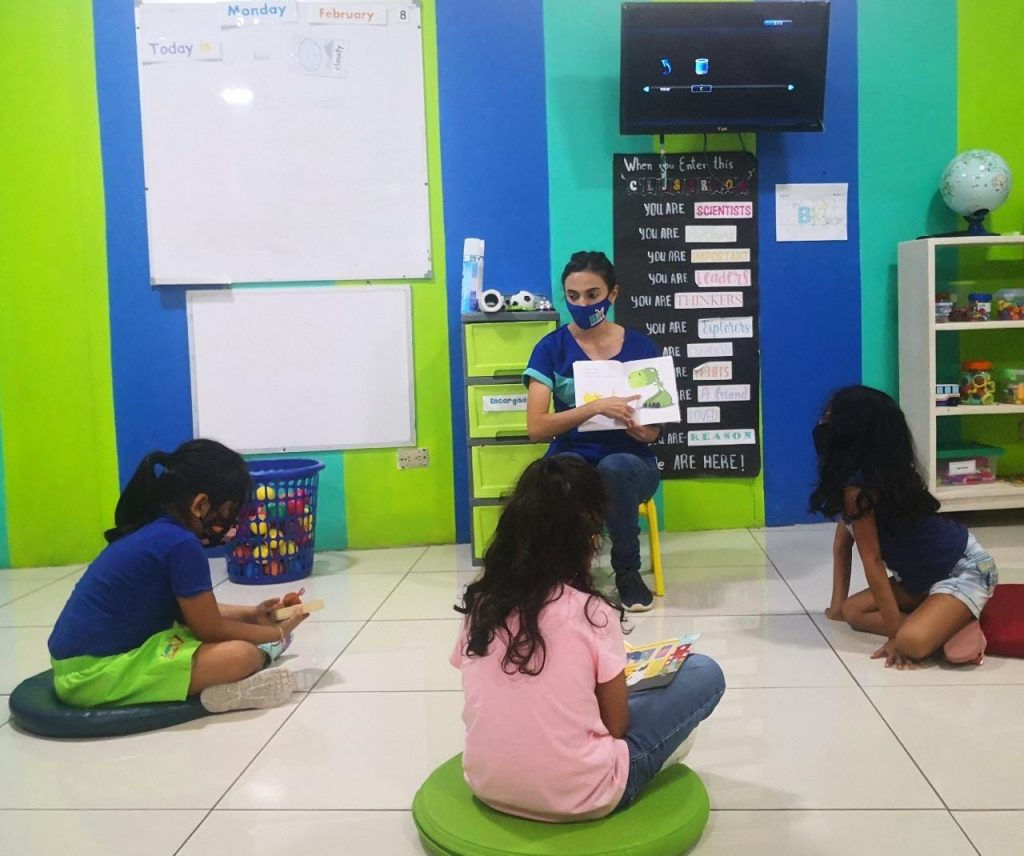 ESL teacher reading to young learners
