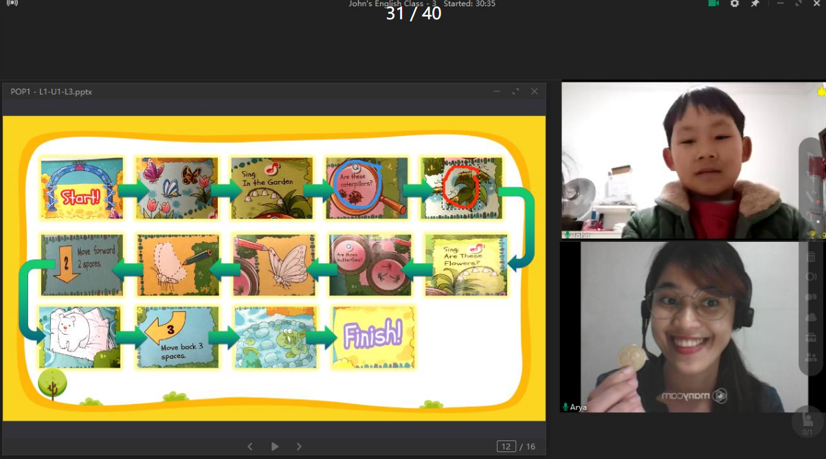 Juicy Mae playing an online board game with her student and using a digital rewards system