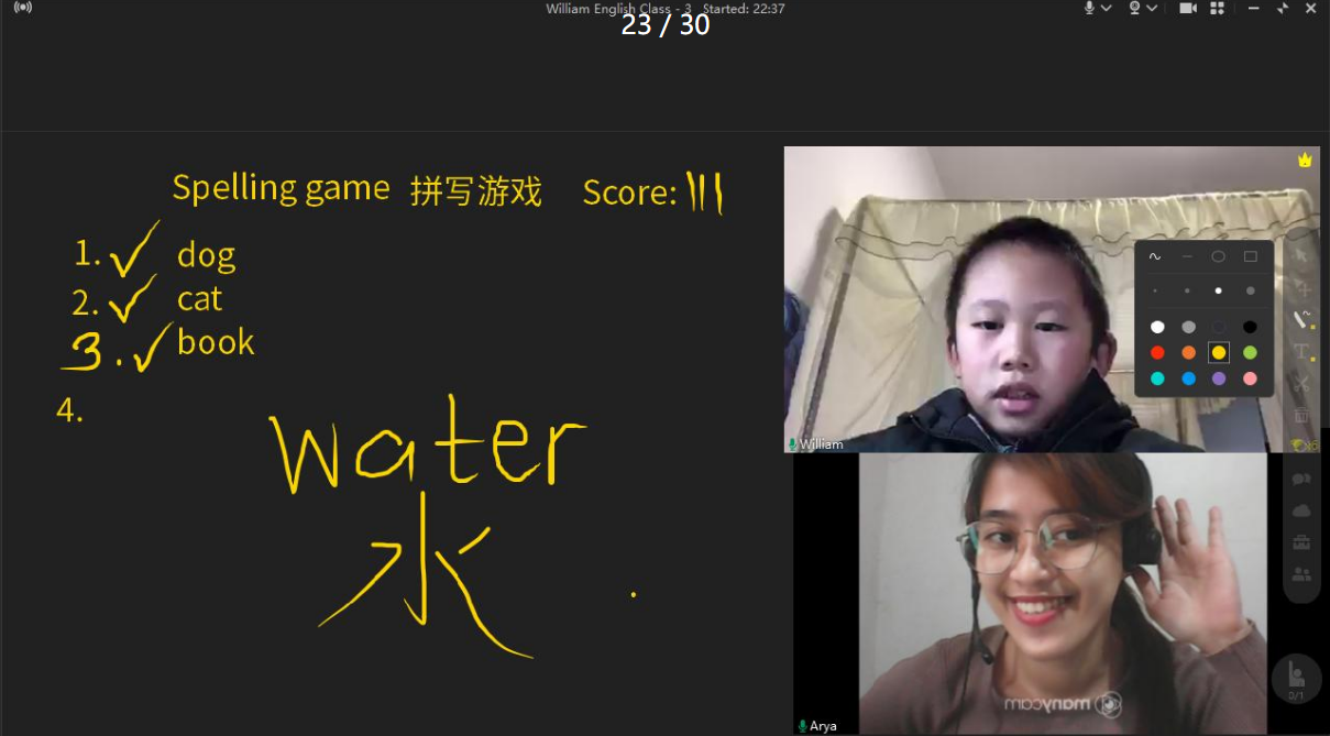 Juicy Mae playing a spelling game with a student