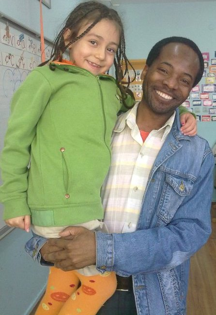 Hassan with one of his young EFL learners