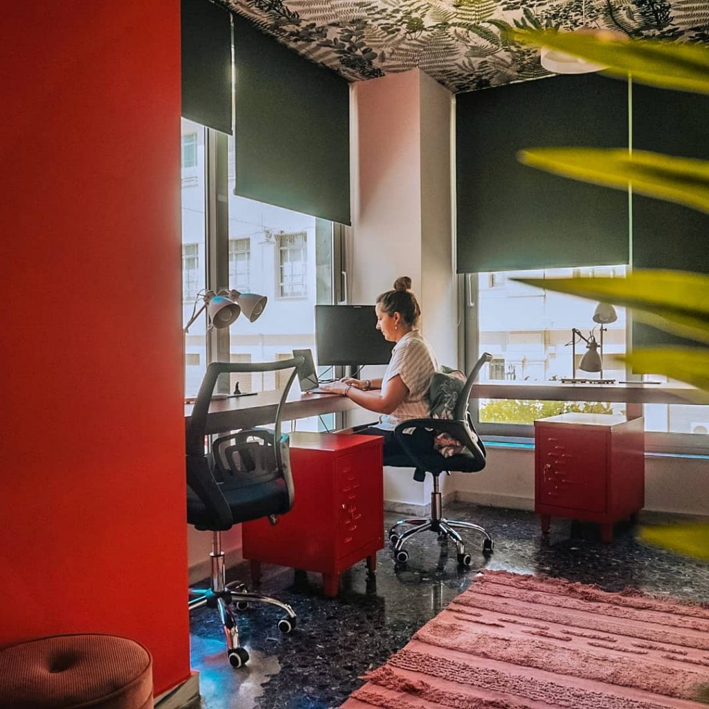 Digital nomad Margarida working in a co-working space in Athens, Greece